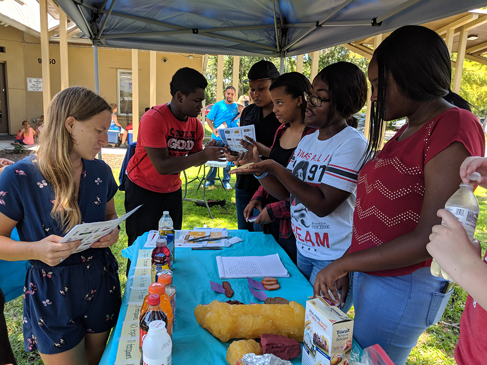 students teaching about nutrition education