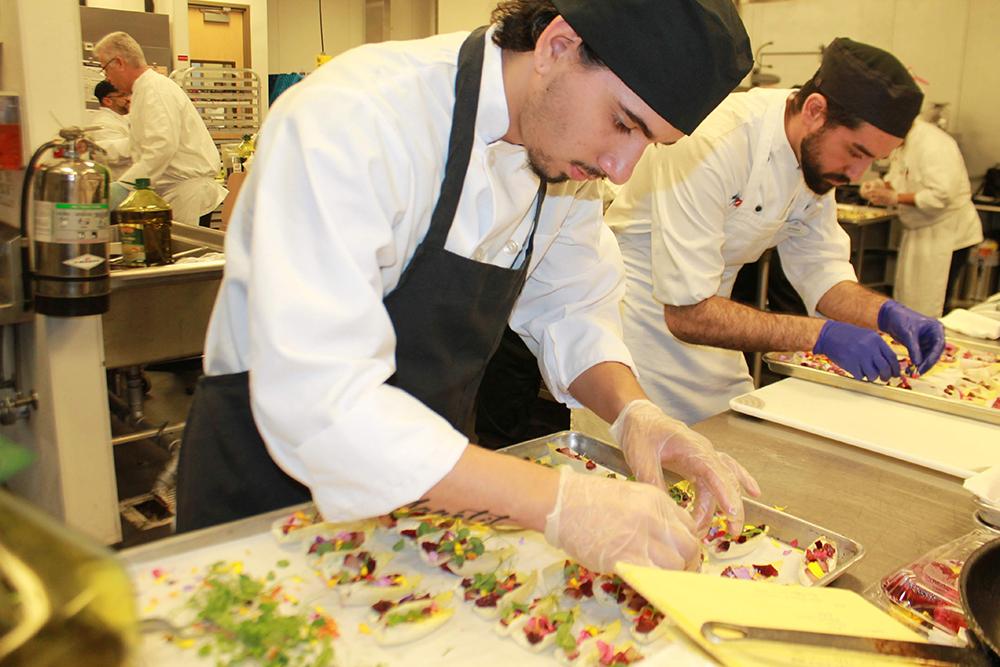 culinary training student making a dish